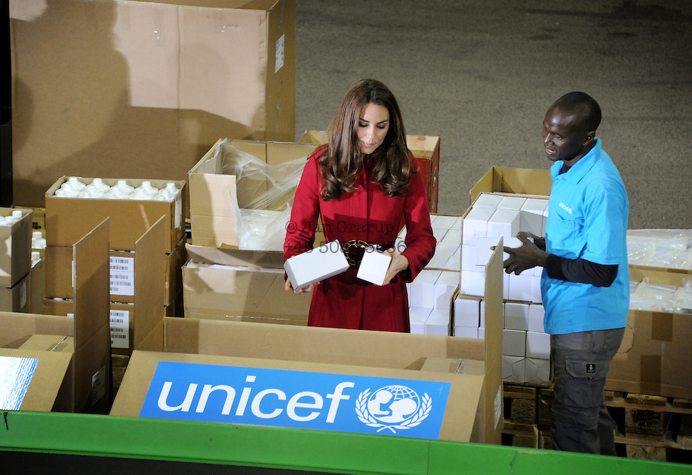 Danish prince frederik and Prince William, together with Princess mary and Princess Kate at the UNICEF warehouse in copenhagen, denmark packing Aid for Africa.