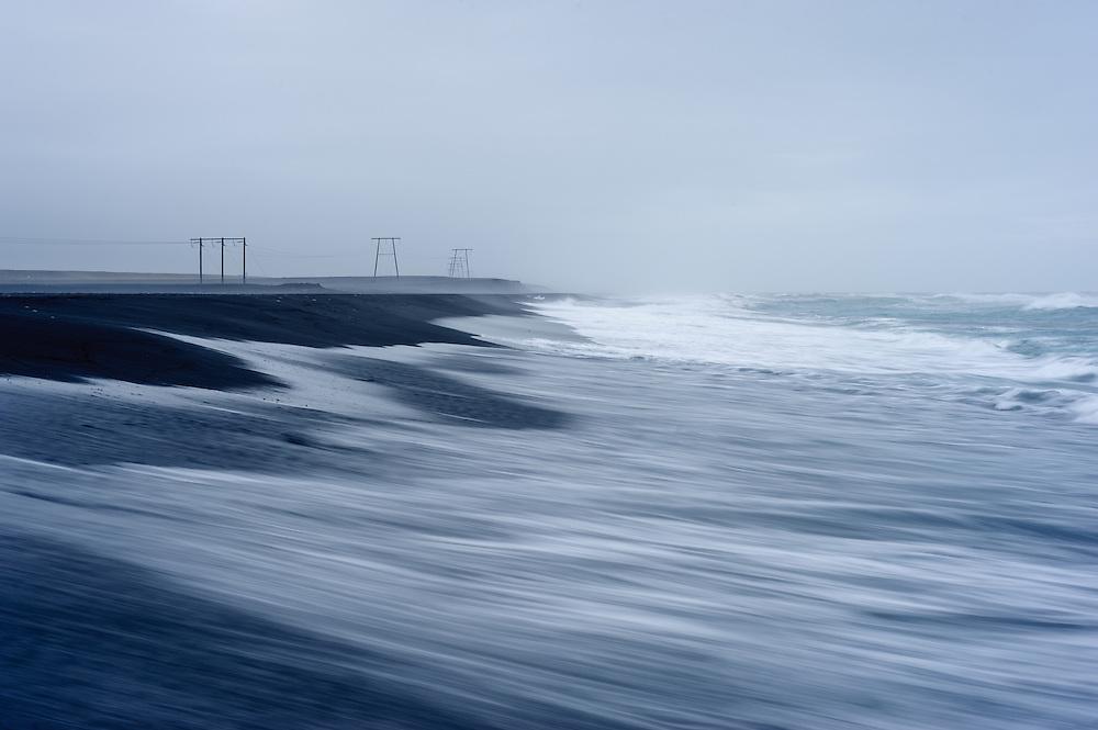 Black beach, Jokulsarlon, with pylons, Iceland