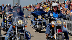 June 3, 2017 - Boone, Iowa, U.S - Senator Joni Ernst Reupblican from Iowa (L) rides her motorcycle as she escorts United States Republican Vice President Mike Pence (R) riding a Harley Daividson motorcycle into the Senator's 3rd annual Roast and Ride charilty benefit at the Central Iowa Expro center in Boone Iowa, 3rd June, 2017. (Credit Image: © Mark Reinstein via ZUMA Wire)