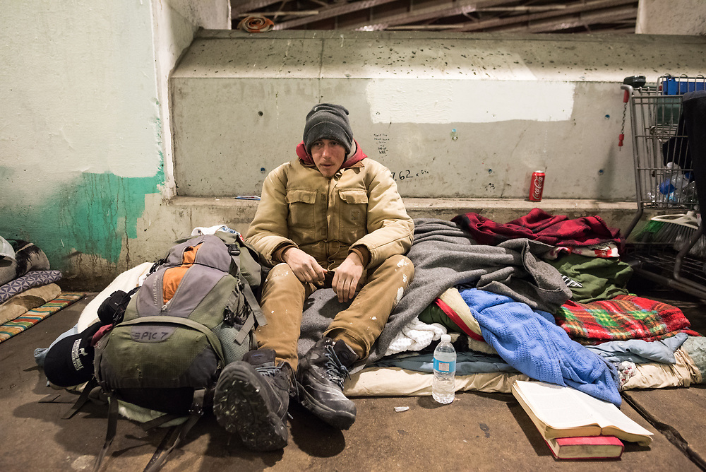 Mike Kradenych sits in his living space underneath the Kennedy Expressway on February 3, 2016 in Chicago. Kradenych, who is one of over 125,000 who are homeless in Chicago, is part of increasing population who lives in encampments under Chicago's expressways despite the constant threat of their belongings being removed by the city or thieves.