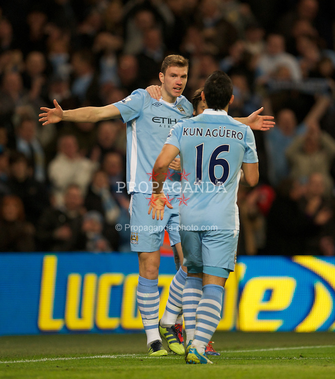 MANCHESTER, ENGLAND - Saturday, February 25, 2012: Manchester City's Edin Dzeko celebrates scoring the third goal against Blackburn Rovers during the Premiership match at City of Manchester Stadium. (Pic by David Rawcliffe/Propaganda)