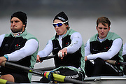 """LONDON, ENGLAND - Thursday  13/12/2012; Cambridge University Crew;  """"Bangers""""  [right to left]  2: Mike Thorp, 3: Josh Hooper and ?4: Alexander Leichter, before the annual Varsity trial 8's for The BNY Melon University Boat Race over the Championship Course [Putney to Mortlake]. The River Thames, England. (Mandatory Credit/ Peter  Spurrier/Intersport Images]"""