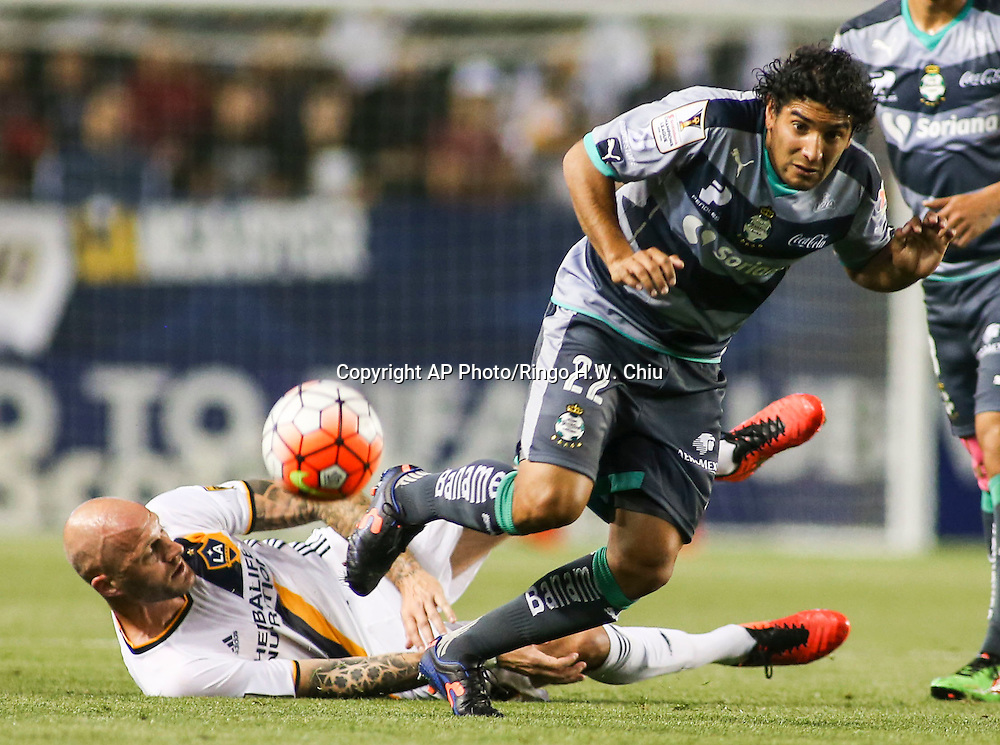 Los Angeles Galaxy defender Jelle Van Damme , left, and Santos Laguna forward Martin Bravo in actions during the first half of a CONCACAF Champions League quarterfinal in Carson, Calif., Wednesday, Feb. 24, 2016. (AP Photo/Ringo H.W. Chiu)