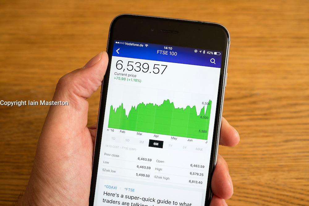 Detail of stock market performance of FTSE   stock exchange  on a smart phone
