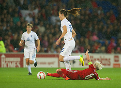 CARDIFF, WALES - Tuesday, August 21, 2014: Wales' captain Jessica Fishlock tackles England's Jill Scott during the FIFA Women's World Cup Canada 2015 Qualifying Group 6 match at the Cardiff City Stadium. (Pic by Ian Cook/Propaganda)