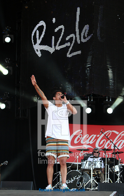 Picture by Paul Terry/Focus Images Ltd. 07545 642257.26/07/12.Jordan Stephens of Rizzle Kicks performs at the London 2012 Olympic Torch Relay Finale Concert in London's Hyde Park,  Presented by Coca Cola. London, England.