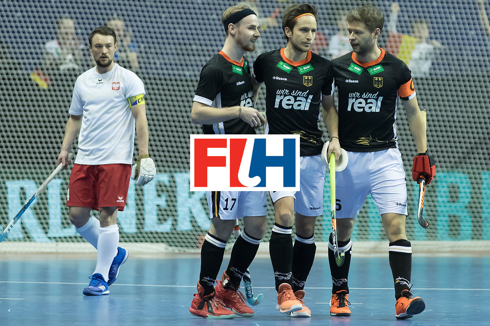 Hockey, Seizoen 2017-2018, 08-02-2018, Berlijn,  Max-Schmelling Halle, WK Zaalhockey 2018 MEN, Poland - Germany 3-6, Goal from RÜHR Christopher (GER) (left), middle MILTKAU Marco (GER) en HANER Martin (GER).