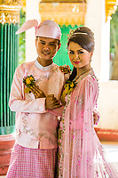 YANGON, MYANMAR - DECEMBER 16, 2016 : Burmese bride and groom posing with traditional cosutmes Shwedagon Pagoda Yangon (Rangoon) in Myanmar (Burma)