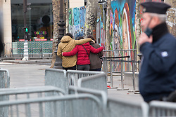 © Licensed to London News Pictures. 10/01/2016. France, Paris. Members of the public visiting the official ceremony can be seen leaving after the event. Family, friends and French Officials holding a ceremony on Place de la Republique in remembrance of the 2015 Charlie Hebdo shootings. Today January 10th 2016. Photo credit: Hugo Michiels/LNP
