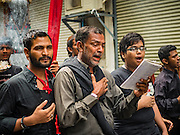 24 OCTOBER 2015 - YANGON, MYANMAR: Shia men weep while they walk in a procession during Ashura observances at Mogul Mosque in Yangon. Ashura commemorates the death of Hussein ibn Ali, the grandson of the Prophet Muhammed, in the 7th century. Hussein ibn Ali is considered by Shia Muslims to be the third imam and the rightful successor of Muhammed. He was killed at the Battle of Karbala in 610 CE on the 10th day of Muharram, the first month of the Islamic calendar. According to Myanmar government statistics, only about 4% of the population is Muslim. Many Muslims have fled Myanmar in recent years because of violence directed against Burmese Muslims by Buddhist nationalists.     PHOTO BY JACK KURTZ