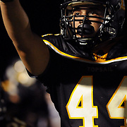 Topsail High School's Josh Jessup points to the crowd after scoring a touchdown against Pender High School Friday August 30, 2013 at Topsail High School. (Jason A. Frizzelle) This collection of images is from the 2013 High School Football in the Cape Fear region.