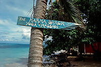 Rustic sign points to yoga studio adjacent to Little Corn Beach & Bungalow, on Little Corn Island, Nicaragua. Copyright 2017 Reid McNally.
