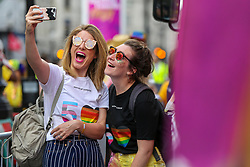 © Licensed to London News Pictures. 06/07/2019. London, UK. Two participants take a selfie during the annual Pride Parade in central London. An estimated over 1 million people lined along the route in support of the LGBT (Lesbian, Gay, Bisexual and Transgender/Transsexual) community. Photo credit: Dinendra Haria/LNP