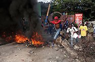 Widespread street protests swept the Haitian capital of Port-au-Prince after preliminary results were announced the night before. Those protesting accused the government of staging a fraudulent election.