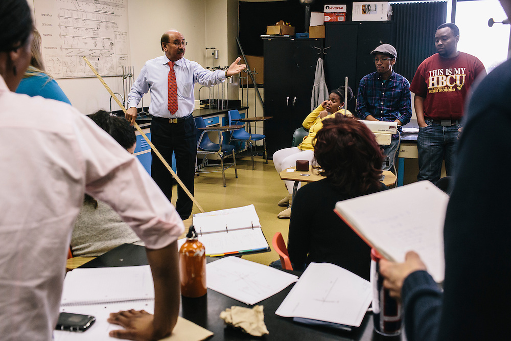Dr. Daryao Khatri, a professor at University of Washington DC, demonstrates Young's Double Slit Experiment during a physics class on Thursday, April 9, 2014. Dr. Khatri uses a variety of different methods to teach physics to students, including forgoing the standard textbook and instead giving students binders full of his lessons.