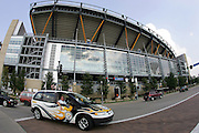 PITTSBURGH - SEPTEMBER 7:  A fan vehicle decked out in Pittsburgh Steelers colors drives toward the parking lot with a general view of the stadium exterior in the background prior to the game against the Miami Dolphins at Heinz Field on September 7, 2006 in Pittsburgh, Pennsylvania. The Steelers defeated the Dolphins 28-17. ©Paul Anthony Spinelli