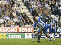Photo: Aidan Ellis.<br /> Wigan Athletic v Newcastle United. The Barclays Premiership. 15/10/2005.<br /> Newcastle's Alan Shearer heads the ball on to the post and claims it crosses the line but no goal was given