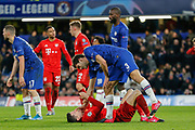 Chelsea defender Marcos Alonso (3) pats the face of Bayern Munich forward Robert Lewandowski (9) who he believes is feigning injury during the Champions League match between Chelsea and Bayern Munich at Stamford Bridge, London, England on 25 February 2020.