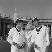 Rome, August 1956. Actress Marlene Dietrich in Saint Peter's Square with two seamen / Roma, agosto 1956. L'attrice Marlene Dietrich in piazza San Pietro con due marinai - Marcello Mencarini Historical Archives