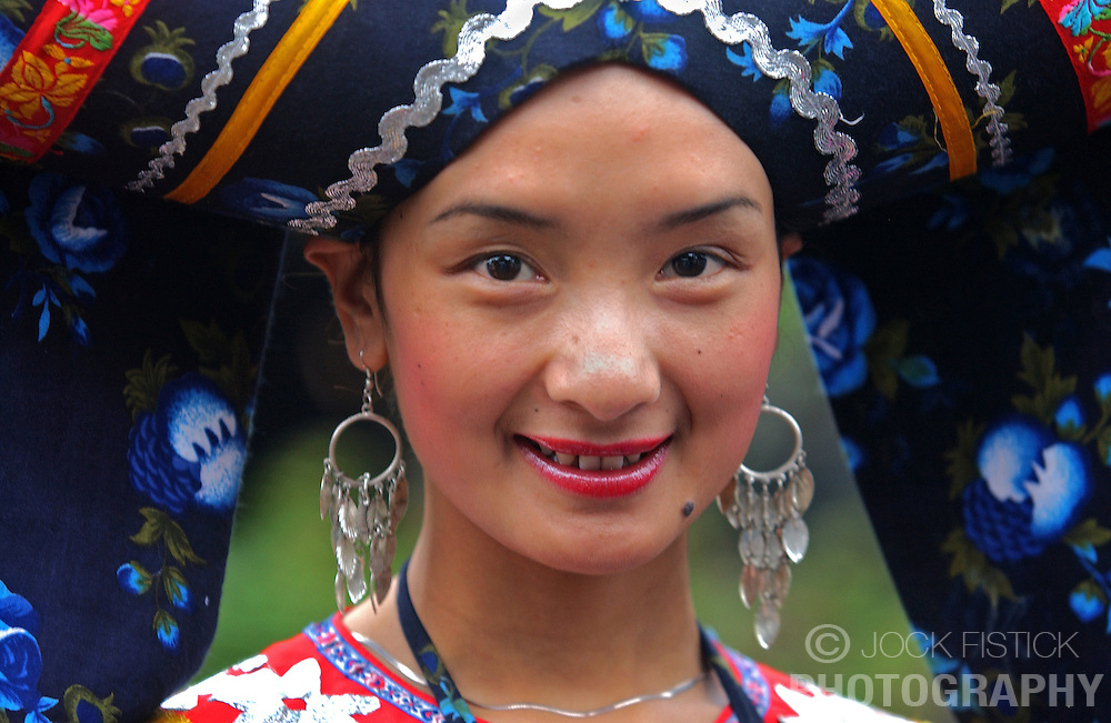 GUILIN, CHINA - Chinese ethnic minorities dress in traditional costumes at a tourist attraction in Guilin, China. (Photo © Jock Fistick)
