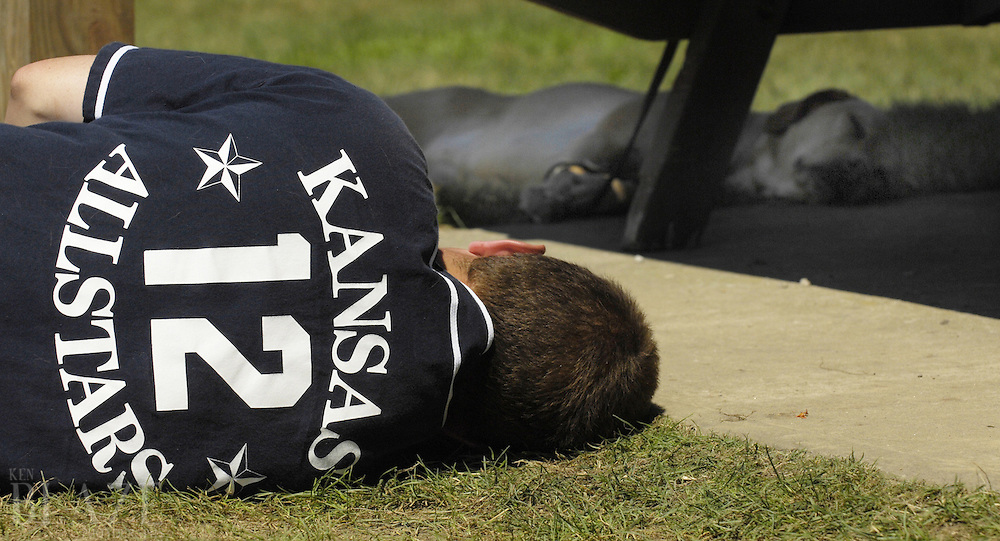 Kansas All-Stars' Chad Sumner takes a nap in the heat at the 2006 World Series of Beep Baseball in Strongsville, Ohio.Photo by Ken Blaze