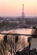 France. Paris. Elevated view on Paris cityscape and the Eiffel tower. Eiffel Tower and Bridge over Seine, The seine river  , Sainte clotilde church bell tower,  the roofs . .