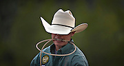 Blane Cox of Cameron, Texas holds the rope firmly in his teeth while preparing to compete in the steer tie down roping in Falkland, BC (2012)