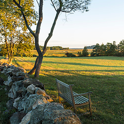 A stone wall and field at the Cox Reservation in Essex, Massachusetts.