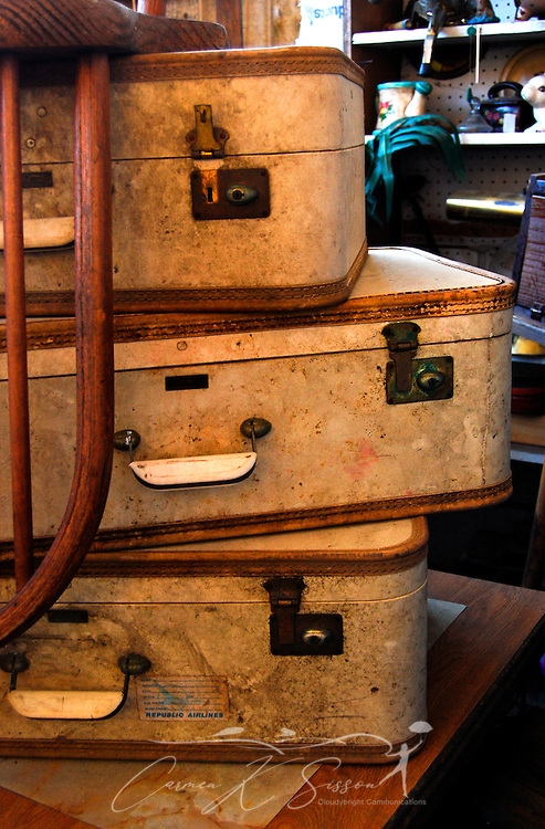 A stack of vintage suitcases sits on a desk Jan. 9, 2011 at the Antique Mall of Meridian in Meridian, Mississippi. The store is open Mondays through Saturdays from 9 a.m. to 5 p.m. (Photo by Carmen K. Sisson/Cloudybright)