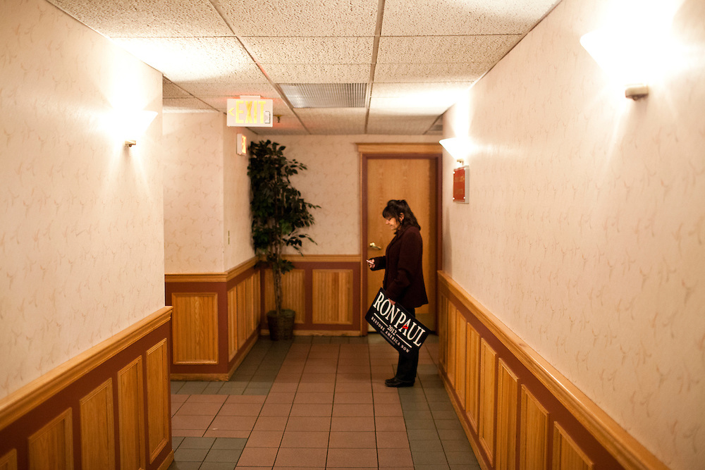 A supporter of Republican presidential candidate Ron Paul awaits the start of his primary night rally at the Executive Court banquet facility on Tuesday, January 10, 2012 in Manchester, NH. Brendan Hoffman for the New York Times