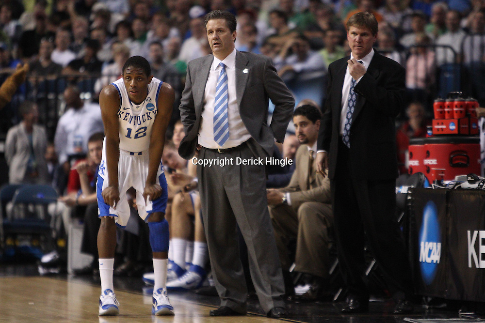 Mar 17, 2011; Tampa, FL, USA; Kentucky Wildcats head coach John Calipari and guard Brandon Knight (12) during second half of the second round of the 2011 NCAA men's basketball tournament against the Princeton Tigers at the St. Pete Times Forum. Kentucky defeated Princeton 59-57.  Mandatory Credit: Derick E. Hingle