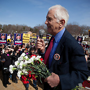 Daniel Ellsberg, a former military analyst, speaks to a crowd of Bradley Manning supporters, who gathered to protest his imprisonment near Quantico Marine Corps base, March 20, 2011. More than two dozen people were arrested during the protest, including Daniel Ellsberg, a former military analyst. The arrests came at the end of a largely peaceful demonstration.