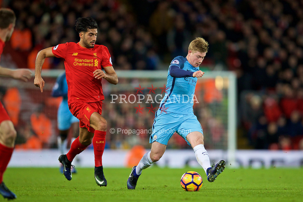 LIVERPOOL, ENGLAND - Saturday, December 31, 2016: Liverpool's Emre Can in action against Manchester City's Kevin De Bruyne during the FA Premier League match at Anfield. (Pic by David Rawcliffe/Propaganda)
