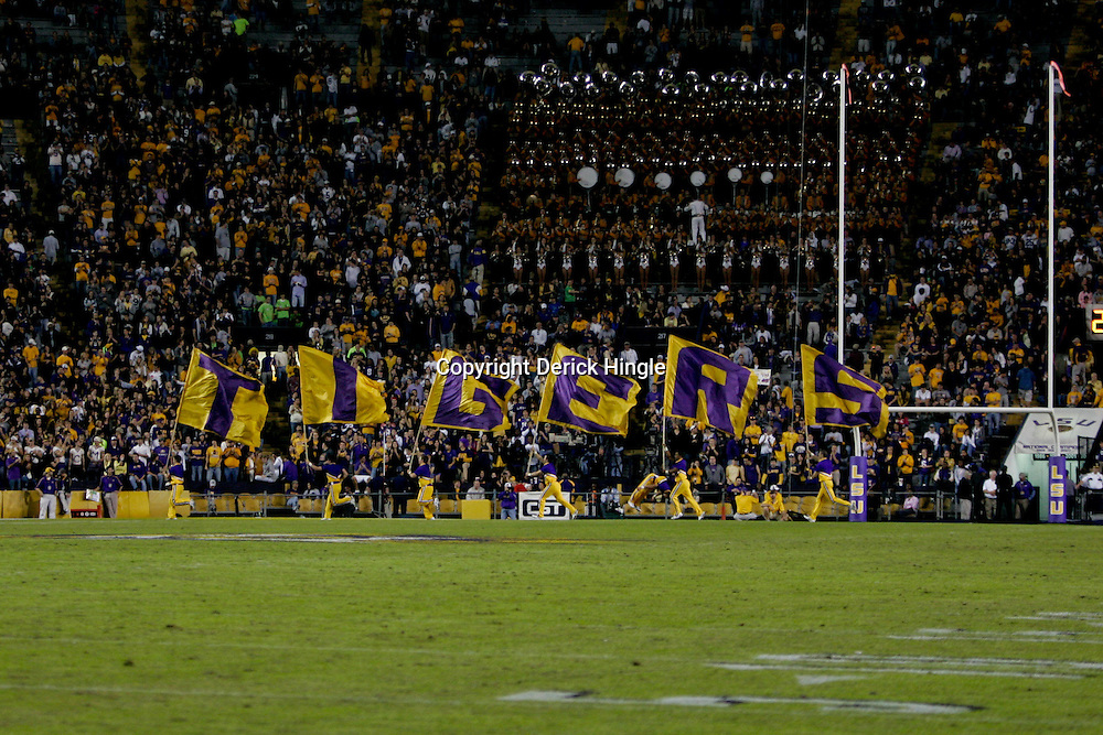 Nov 14, 2009; Baton Rouge, LA, USA;  LSU Tigers cheerleaders run with flags after a score against the Louisiana Tech Bulldogs during the second half at Tiger Stadium. LSU defeated Louisiana Tech 24-16. Mandatory Credit: Derick E. Hingle-US PRESSWIRE