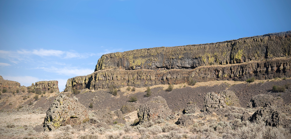Dry Falls is the remnant of what was once the largest waterfall known to have existed on earth.  There are 3.5 miles of sheer cliffs that drop 400 feet.  During the last ice age catastrophic flooding channeled water at 65 miles per hour through the Upper Grand Coulee and over this 400-foot rock face.  The falls are on an ancient course of the Columbia River.