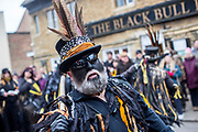 UNITED KINGDOM, Whittlesey: Straw Bear Festival. Members of The Witchmen Morris dancers perform during the Straw Bear festival this weekend. A number of theories for the black face paint exist, from Moorish mimicry to a form of disguise.The three day festival, which originated in 1882, consists of traditional Molly, Morris, Clog and Sword dancing as well as parading a large straw character known as 'The Bear' through the town. Rick Findler  / Story Picture Agency