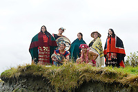First Nations people display their regalia at Thomas Point bluff near Fort Rupert on Northern Vancouver Island.  British Columbia, Canada.