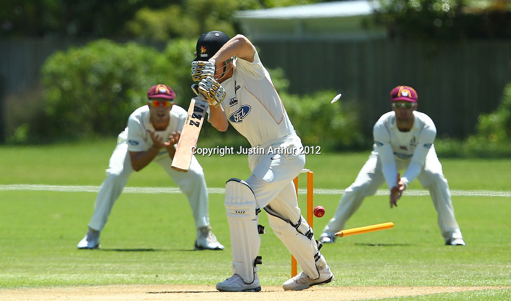 Scott Kuggeleijn is bowled by Brent Arnel. Plunket Shield Cricket - Wellington v Northen Districts ,Karori Park, Wellington, New Zealand on Wednesday 19 December 2012. Photo: Justin Arthur / photosport.co.nz