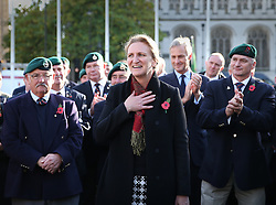 © Licensed to London News Pictures. 28/10/2015. London, UK. Claire Blackman (C) receives applause from Marines in Parliament Square during a rally calling for her husband, Sgt Alexander Blackman to be released.  Sgt Blackman was sentence for killing a Talliban insurgent in Afghanistan in 2011. He was convicted of murder at a court martial in 2013.   Photo credit: Peter Macdiarmid/LNP