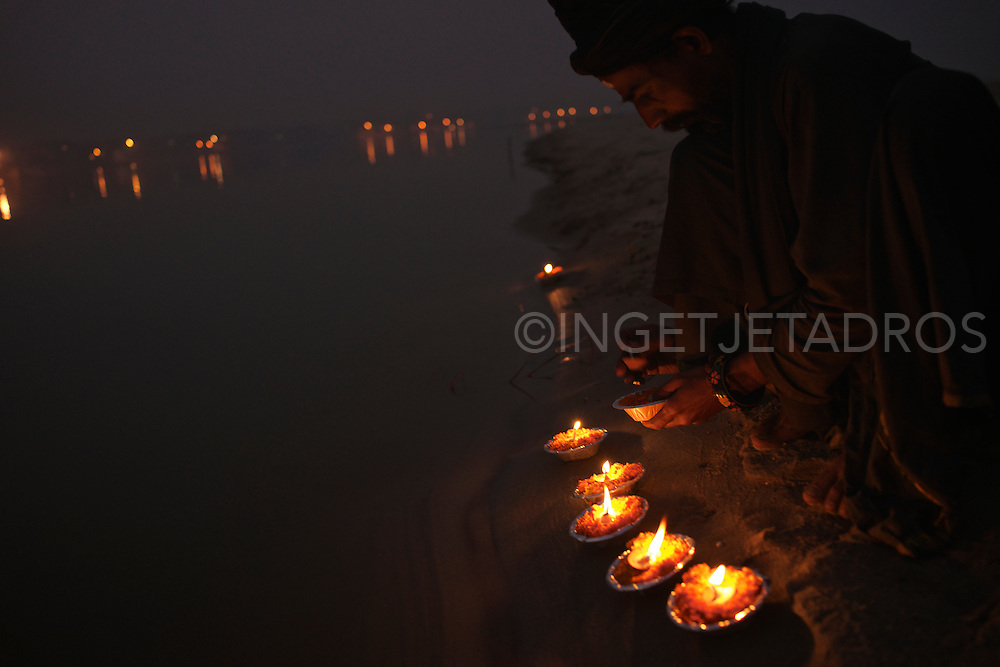 Aghori Sadhu, Rahm, prepares 109 candles to be burned in a large circle, which is a part of the Sasan Kali Spiritual Ritual, some of these candles are put in the Ganges while singing a Mantra. Varanasi, India.