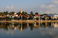Burma/Myanmar, Kentung. Panoramic view of Kentung - the capital of the Golden Triangle. Reflection in the water of Naung Tung Lake.