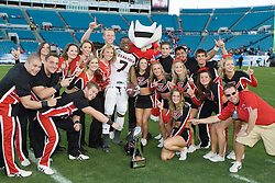 Texas Tech safety Darcel McBath (7) celebrates with TTU cheerleaders after winning the Gator Bowl.  The Texas Tech Red Raiders defeated the Virginia Cavaliers 31-28 in the 2008 Konica Menolta Gator Bowl held at the Jacksonville Municipal Stadium in Jacksonville, FL on January 1, 2008.