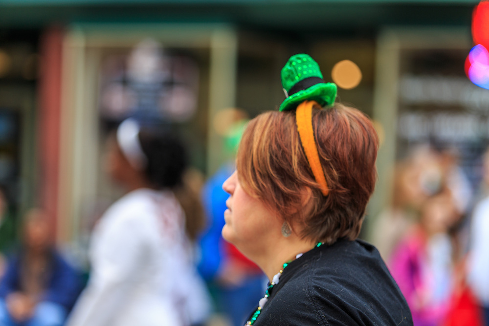 York, PA / USA - March 12, 2016: A woman wears a head band with a green hat at the annual Saint Patrick's Day Parade.