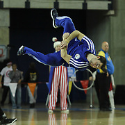 A member of the Philadelphia 76ers flight squad performs spectacular gymnastic moves during a time out of a NBA D-league regular season basketball game between Delaware 87ers (76ers) and the Erie BayHawks (Knicks) Friday, Jan. 3, 2014 at The Bob Carpenter Sports Convocation Center, Newark, DE
