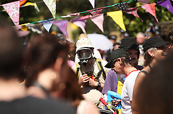 26/05/12. Pics © Copyright Julian Andrews 2012...UK Uncut protestors gather out side the Putney (SW London) home of Deputy Prime Minister Nick Clegg...The protest was largely humorous, musical, and jovial with police and protestors seeming to all enjoy the fantastic sunshine.UK Uncut protestors gather outside the home of Deputy Prime Minister Nick Clegg in Putney, South West London. The protest was largely humorous, musical, and jovial with police and protestors seeming to all enjoy the fantastic sunshine, Saturday May 26, 2012. Photo By Julian Andrews/i-Images
