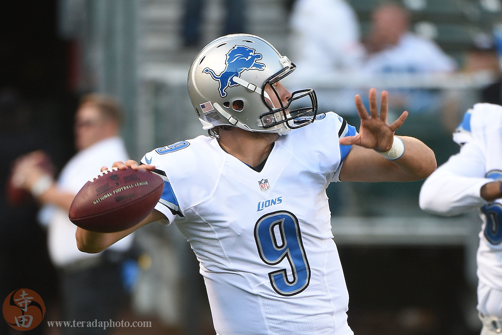 August 15, 2014; Oakland, CA, USA; Detroit Lions quarterback Matthew Stafford (9) warms up before the game against the Oakland Raiders at O.co Coliseum.