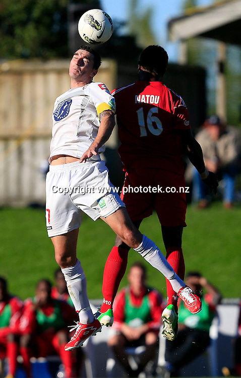 Waitakere's Jake Butler wins the ball over Amicale's Daniel Natou. OFC Champions League 2013, 2nd Leg Semi Final, Waitakere United v Amicale FC, Fred Taylor Park Waitakere, Sunday 12th May 2013. Photo: Shane Wenzlick