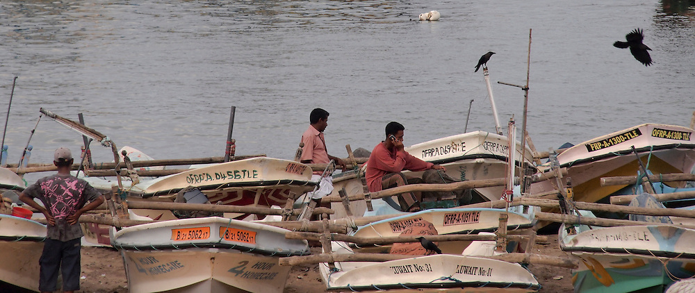 Fishermen work on their fishing boats at the Hanbantota sea-port, in Sri Lanka, on February 26, 2011