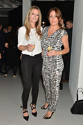 Left to right, DAISY DICKSON and NATALIE PINKHAM at the Audemars Piguet Royal Oak Offshore 42mm Party held at Victoria House, Bloomsbury Square, London on 23rd April 2014.