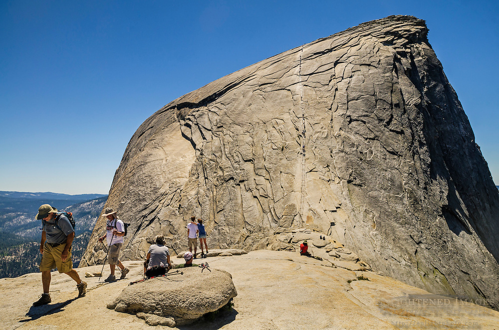 Hikers on the subdome just before the cables section route up Half Dome, Yosemite National Park, California